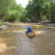 Navigating the Santa Cruz River by boat