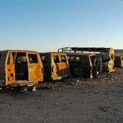 Burned out migrant vans, Sonora