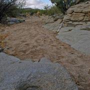 Photo: Desert wash with O'odham grinding hole