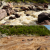 Photo comparison of La Morita rapid in medium and high flows